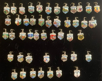 Vintage Hand Painted European Travel Shield Charms in 800 835 silver 1940s to 1950s each Sold Separately @ 12 dollars each