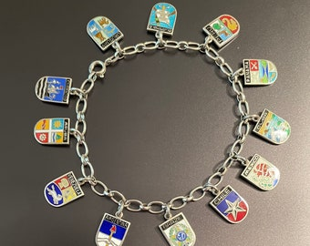 South American and southern Caribbean Travel Themed Charm Bracelet Vintage 1950 1960 Silver 12 Travel Shields