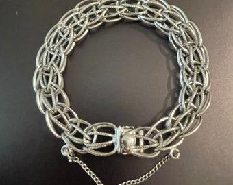 1960s Sterling Silver marked Y.R. Charm Bracelet