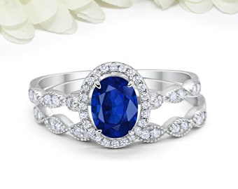 1.65 Carat Oval Blue Sapphire CZ Art Deco Solitaire Accent Dazzling Wedding Engagement Ring Band Two Piece Round CZ Sterling Silver