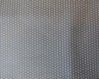 Fabric patchwork background blue gray to light blue polka dots