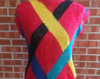 Vintage 80s Donagain red, yellow, black, and teal sleeveless sweater. Size medium