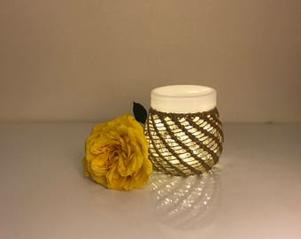 Glass jar with twine macramé