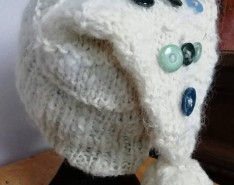 113572aaa9a Adorably soft handspun wool beanie bobble hat for a man or woman in shades  of natural cream with blue green vintage buttons and a bobble.