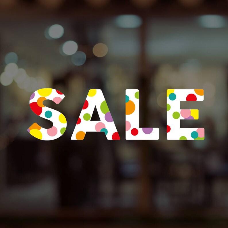 d2172833452 Vitrine colorée vente boutique signe amovible en vinyle