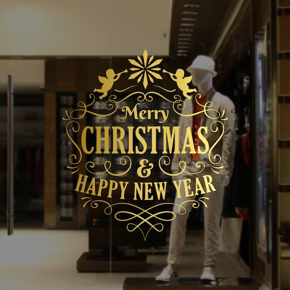 stickers adesivi buon natale happy new year allestimento vetrine vetrofanie