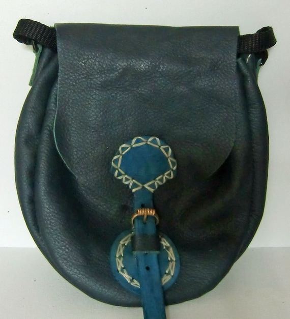Soft dark navy leather belt pouch with eyelets for strap if required.