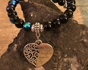Blue glass bead memory wire bracelet and silver plated heart charm