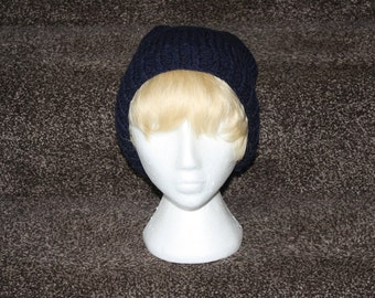 """A """"blueberry"""" beanie, hand knitted."""