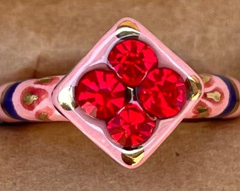 Size 8.25 Light Pink, Navy Blue and Red ceramic ring with 22kt gold accents and bright red glass rhinestones.