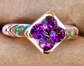 Discounted Size 8.75 turquoise and pink with white speckles ceramic ring with 22kt gold accents and purple glass rhinestones.