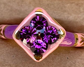 Size 11.5 Purple and Light Pink ceramic ring with 22kt gold accents and Purple glass rhinestones.
