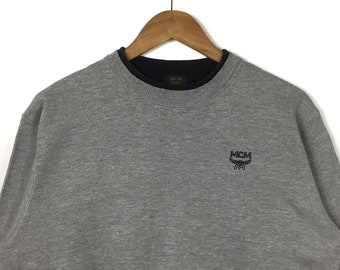 fd54d0611a8e7 Gray Pullover Crew Neck Sweatshirt MODE CREATION MUNICH Gold Mcm Embroidery  Spell Out Small Logo Mcm Fashion Clothing Size Medium