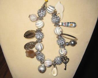 White and black stretch charm bracelet