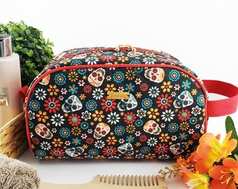 Half Moon toiletry bag made of cotton and structured for form, zippered taco pouch with handle - black and Mexican skulls / la catrina print