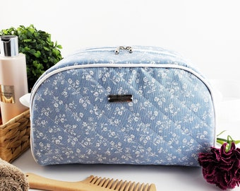Half Moon toiletry bag made of cotton and structured for form, zippered taco pouch with handle - light blue and white flower branches