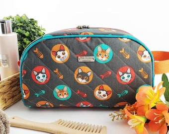 Half Moon toiletry bag made of cotton and structured for form, zippered taco pouch with handle - grey background with cats