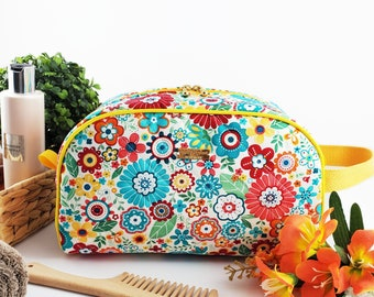 Half Moon toiletry bag made of cotton and structured for form, zippered taco pouch with handle - colourful flowers