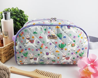 Half Moon toiletry bag made of cotton and structured for form, zippered taco pouch with handle - grey and purple with llama / alpaca print