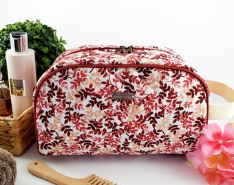 Half Moon toiletry bag made of cotton and structured for form, zippered taco pouch with handle - red, burgundy, and beige flower branches