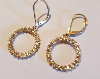 Rhinestone circles dangle drop earrings.