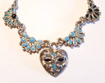 Blue heart pendant filagree necklace.