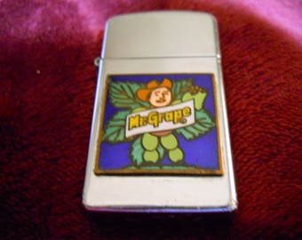 Mr Grape Zippo Lighter made by Zippo possibly for Merck employees in the 60's or 70's