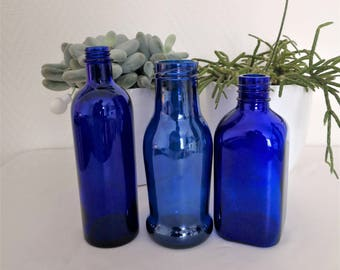 french vintage set of blue glass apothecary bottles