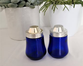 french vintage plastic and blue glass salt/pepper shakers