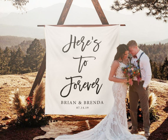 Here S To Forever Banner Custom Wedding Backdrop For Reception Rustic Wedding Decorations Calligraphy Backdrop Wedding Backdrop Ideas By Blushingdrops Catch My Party