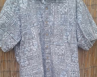 Cooke Street Honolulu size medium Hawaiian shirt with a dark blue background featuring stylized village scenes in cream.