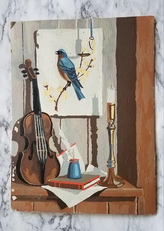 Vintage completed paint by number bird and violin vignette scene.