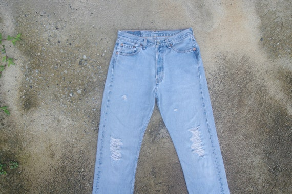 Faded jeans, vintage levis 501 blue jeans W28 L32,