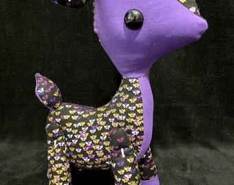 Purple and gold plush deer