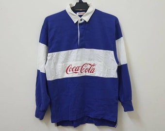 9eed4bf4d4f Vintage 90s 1990 COCA COLA rugby coke patches polo t shirt hype dope swag  hip hop rap style