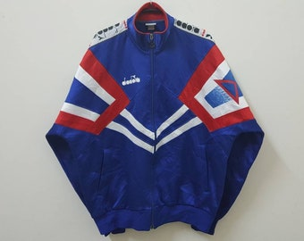 Vintage 90s DIADORA match winner jacket side tape spell out streetwear casual hype dope swag style