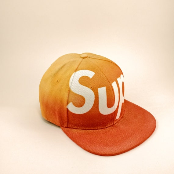 33c1f24559f low cost supreme inspired sup snapback hat gold graffiti spraypaint etsy  076b4 c0ff8