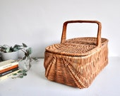 Vintage rattan wicker picnic basket or hamper from the 1970s