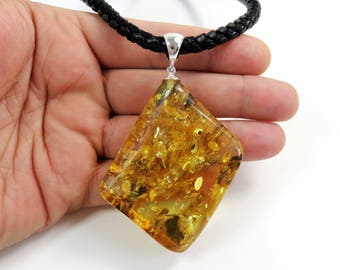 Baltic amber pendant etsy huge 3430 grams stunning cognac glittering natural genuine baltic amber pendant 925 sterling silver on 6mm leather cord necklace aloadofball Images