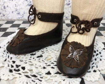 """Leather doll shoes 10 cm  -   3 7\8 """" French style for an antique doll dark brown with brown silk rosettes and metal butterflies."""