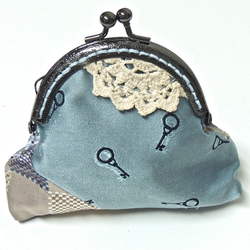 coin purse ultra dark gold with a gold embroidered spiderweb