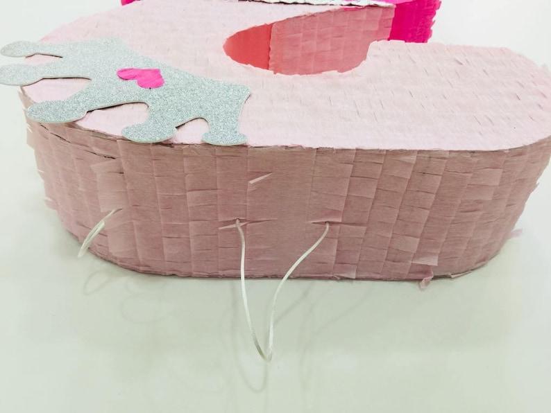Pink Pi\u00f1ata with silver crown