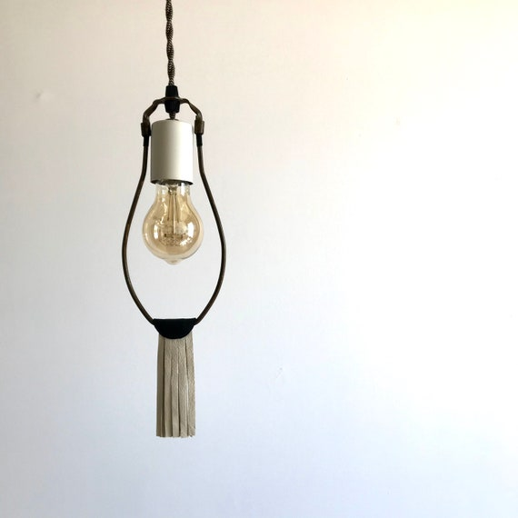 La Madone - Upcycled lighting - Pendant light - Antique brass and cream metal, black and white leather fringes