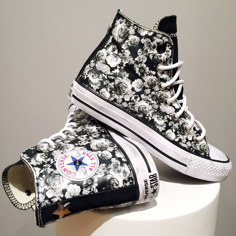 7e505a94582fe Converse All Star Chuck Taylor Custom, black Sneakers with studs and white  rose fabric