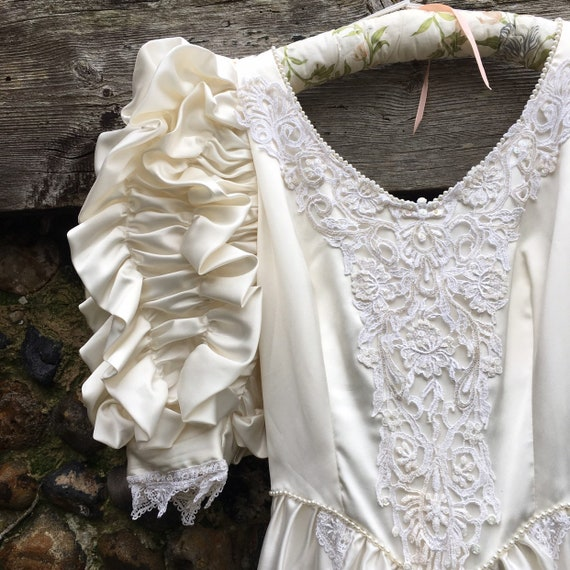 Vintage 80s puff sleeve wedding dress.