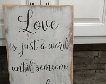 Love is just a word wooden sign