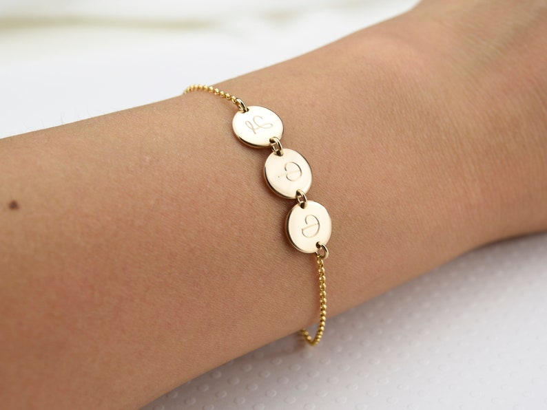 Is your mother's wrist a little empty now? If your answer is yes, try this gift idea - Multi Initial Dainty Disc Bracelet. The bracelet has dainty discs for you to engrave your mom's initials or her important people's initials on. With this unique design, it would become a very thoughtful and beautiful gift for mom this mother's day. She would wear it all the time full of happiness.