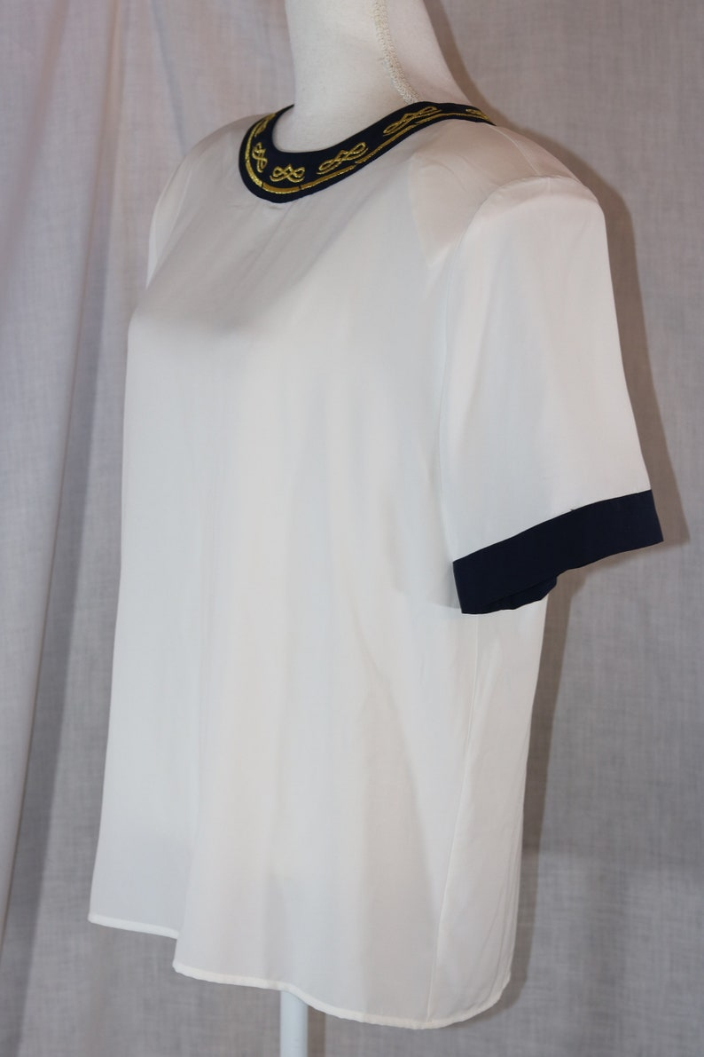 Vintage TESS White Polyester Black Embroidered Trim Short Sleeve Pullover Blouse Size Large