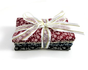 4 Fat Quarters Bundle, Red, Cream, Blue, and Black with Floral Accents