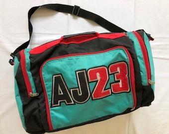 f96a58e856a1 Vintage 90 s Nike Michael Jordan Multicolor Duffle Bag AJ23